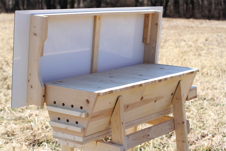 "Top bar hives are distinguished by their horizontal design and ""top bars."""